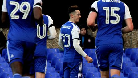 Ipswich players rush to celebrate with goalscorer Tom Lawrence. Photo: James Ager