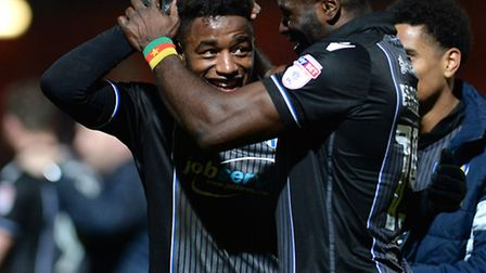 Tarique Fosu is congratulated by George Elokobi after scoring at Stevenage