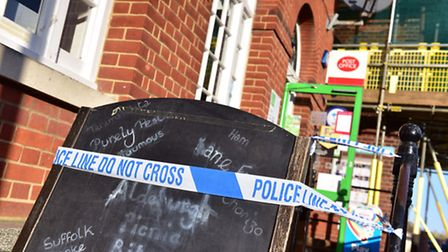 Police investigate the scene of a robbery at the Co-Op on Aldeburgh High Street.