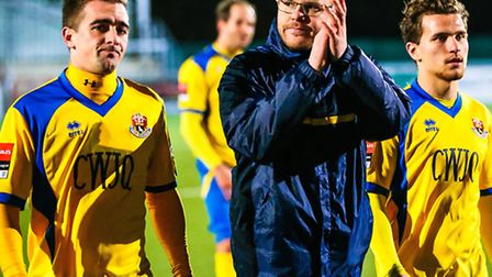 AFC Sudbury Assistant manager Andy Reynolds applauds Sudbury supporters