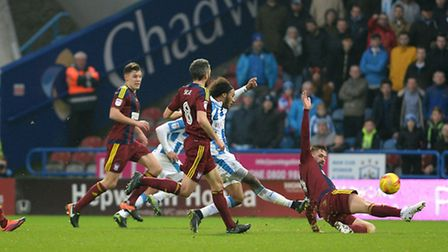 Isaiah Brown opens the scoring for Huddersfield just before half-time against Ipswich