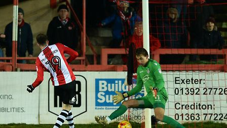 Liam McAlinden of Exeter City scores his sides third goal to make the scoreline 3-0 - Exeter City vs