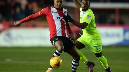 Ollie Watkins of Exeter City looks to get past Tariqe Fosu of Colchester United - Exeter City vs. Co