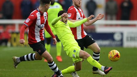 Drey Wright of Colchester United does battle with Jake Taylor of Exeter City - Exeter City vs. Colch