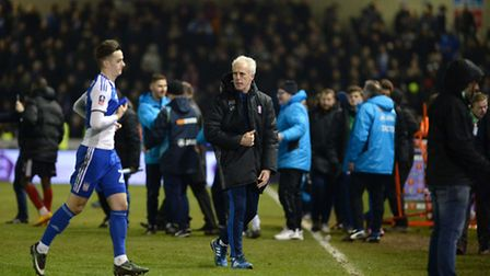 Mick McCarthy walks off the pitch at Sincil Bank last night after the defeat