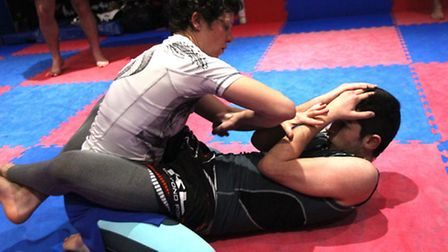 Wendy McKenna perfecting her chain wrestling skills at BKK with Charlie Falco
