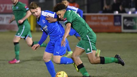 Leiston's Byron Lawrence (blue) in action against Canvey last night