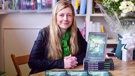 Author Jeanette Hewitt with her Chernobyl-based crime novel Exclusion Zone.