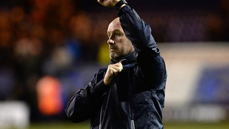 John McGreal celebrates his side's win at Kenilworth Road, Luton, on Boxing Day