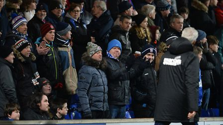 Mick McCarthy makes his way to the dug-outs past fans at Portman Road last night
