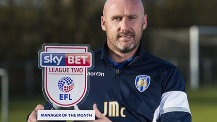 John McGreal with his manager-of-the-month award for December