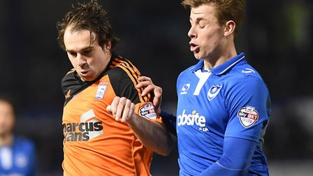 Adam Webster (right) pictured in FA Cup action for Portsmouth against Ipswich Town striker Brett Pit