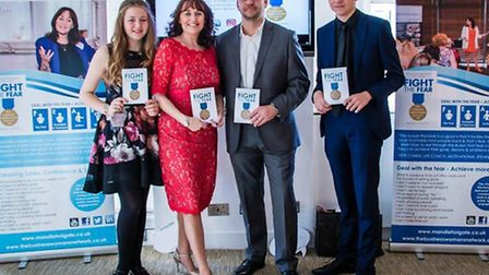 Mandie Holgate at her book launch, with daughter Sophie, husband Andy and son Harrison. Photo: Carol