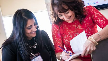 Mandie signs a book at her launch. Caroline Horne Suffolk Photography