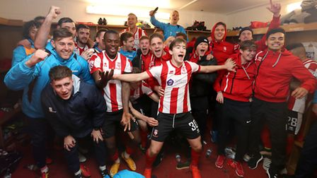Lincoln City's Alex Woodyard celebrates with teammates in the dressing room after the Emirates FA Cu