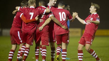League leaders Needham Market celebrate a goal against Harlow in a recent game.