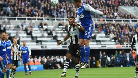 Adam Webster rises to win a header in the Newcastle penalty area during the first half