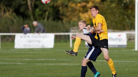 Hadleigh's Kyle Cassell (left) is out of the game at Godmanchester