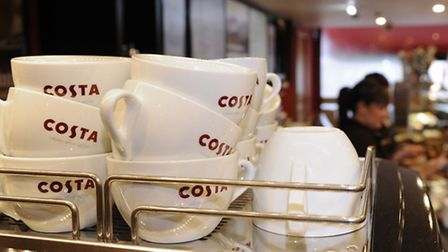 Staff at work at a Costa coffee shop. Photo: Joe Giddens/PA Wire