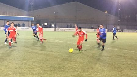 Action from Tuesday night's game at Wingate & Finchley. Leiston left wing-back Seb Dunbar is on the