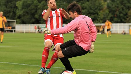 Felixstowe's leading scorer Craig Jennings clashes with Mildenhall's 'keeper Josh Pope in the 2-0 wi