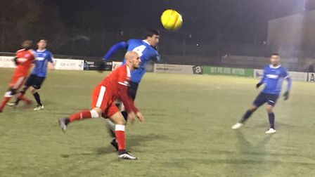 Matt Blake, red shirt, in action at Wingate & Finchley tonight