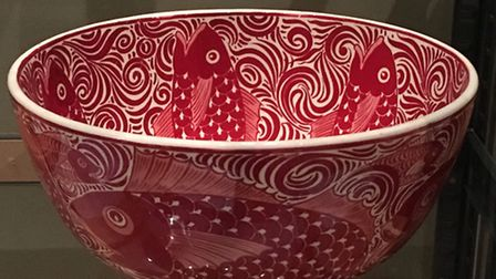 The bold, red, glazed pottery piece, created in a Persian style by British designer William De Morga