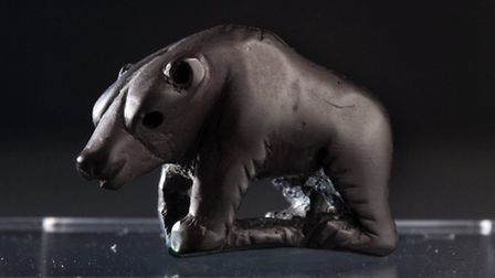 The bear pendant, made of jet, found in a Roman child's grave