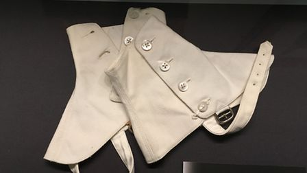 Spats (1925): A short cloth gaiter covering the instep and ankle. Became fashionable with men in the