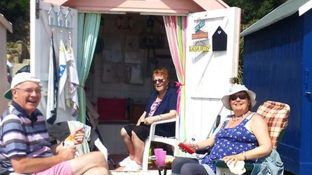 Sarah Caddick with Brenda (seated inside the hut) and Phil (l)