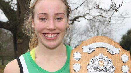 Holly Davies, with her shield from the Suffolk Championships, was a fine third at the Anglian School