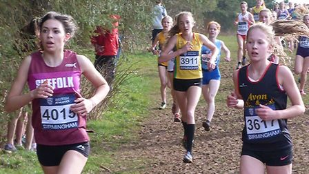 Olivia Allum, left, who was Suffolk's first finisher in the intermediate girls' race at the Anglian