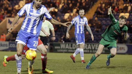 Kurtis Guthrie prepares to crash home one of his hat-trick goals in Colchester United's last home ma
