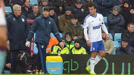 Steven Taylor makes his way to the changing rooms after coming off injured during the first half at