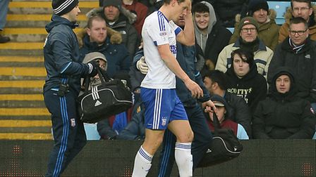 Christophe Berra is substituted after being struck by Tommy Elphick's flailing arm at Villa Park