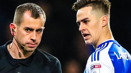 Tom Lawrence having words with referee Peter Bankes during Ipswich Town's game against Nottingham Fo