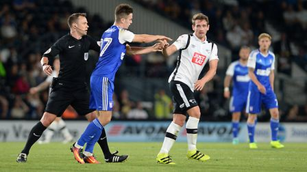 Tom Lawrence shoves Derby's Craig Bryson on his Ipswich Town debut. Photo: PAGEPIX LTD