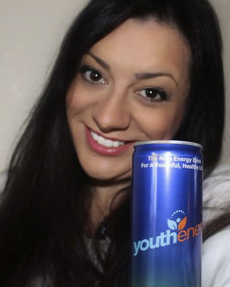 Amanda Freeman with a can of the Youth Energy drink