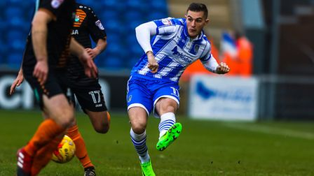 Brennan Dickenson fires in a cross during last weekend's 2-1 home win over Barnet. Picture: STEVE WA