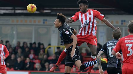 Kurtis Guthrie is beaten in the air by Omar Beckles at Accrington Stanley this afternoon. Picture: P
