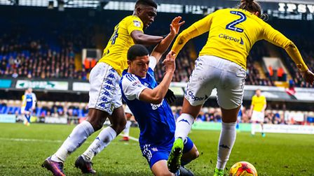 Town's Myles Kenlock is crowded out by Luke Ayling (2) and Hadi Sacko of Leeds. Picture: Steve Wall