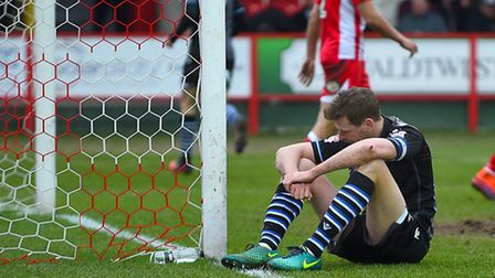 Chris Porter sits on the ground in disappointment after a second-half chance goes begging at Accring
