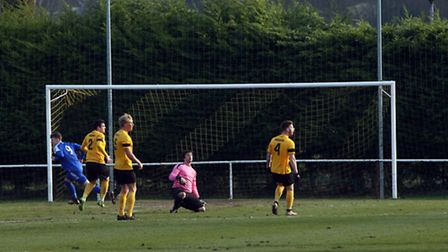 Wanderers open the scoring in the first half as the Mildenhall players look for an offside.