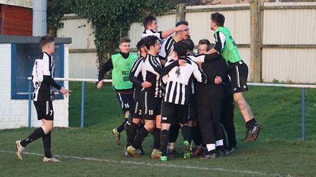 Woodbridge celebrate a goal in their win at Holland FC