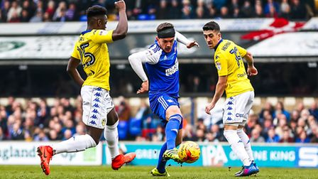 Town's Emyr Huws beats Ronaldo Vieira (25) and Pablo Hernandez to the ball in this battle during the