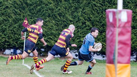 Jamie Smith scores one of his two tries for Woodbridge against YM