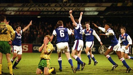 Norwich City's Gary Megson slumps to his knees after scoring a last-gasp own goal against Ipswich in