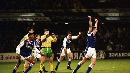 Town players running off in celebration after Norwich's Gary Megson heads an own goal in 1993