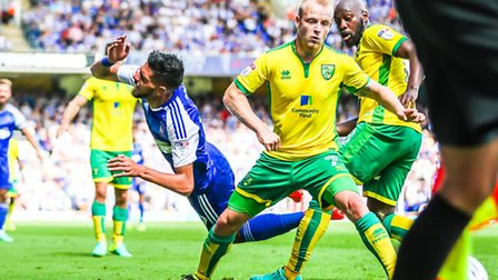 Kevin Bru and Steven Naismith in action during the Ipswich Town v Norwich City match at Portman Road
