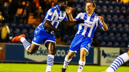 Tom Lapslie, right, is quick to congratulate George Elokobi on scoring what proved to be the winner